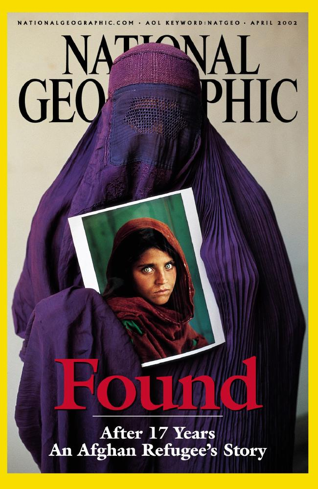 Sharbat Gula holds her portrait, which became the most famous picture ever to appear on the cover of National Geographic magazine. Picture: AP Photo/National Geographic Society, Steve McCurry