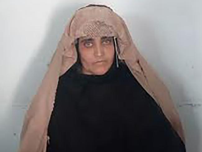 Sharbat Gula, the 'Afghan Girl', awaits her court hearing in Peshawar. Picture: AFP/FIA