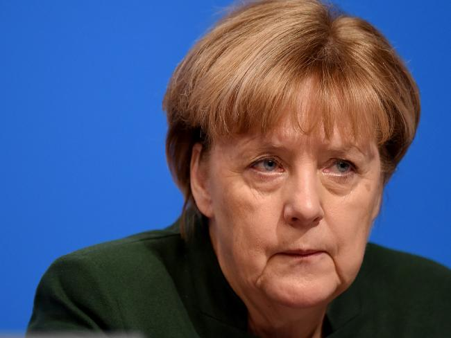 German Chancellor Angela Merkel called for a ban on the burka and priority for German laws in her most conservative speech in years at the party conference where she won re-election this week. Picture: Volker Hartmann/Getty Images