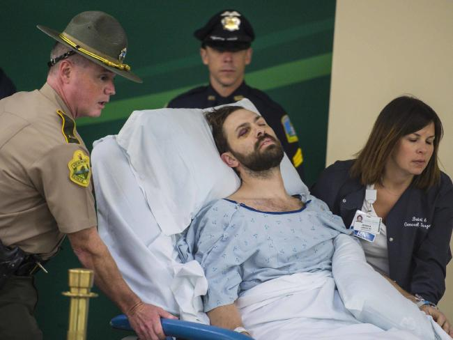 A week after the crash, Steven Bourgoin was brought to a makeshift courtroom to face charges over the deaths. Picture: Glenn Russell/The Burlington Free Press via AP, Pool