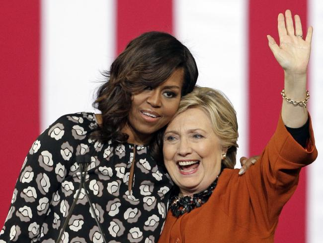 If she runs for mayor of New York, Hillary Clinton could again bring out everybody's favourite, Michelle Obama. Picture: AP/Chuck Burton