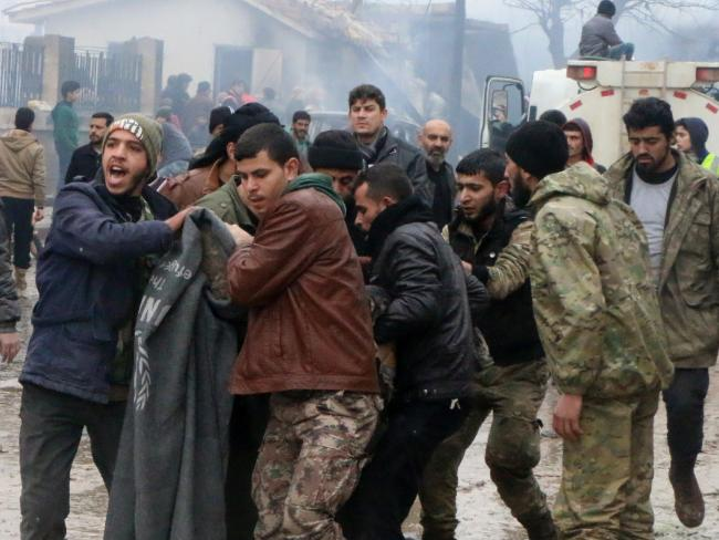 Rescue workers attend to those injured after dozens were killed when a car bomb went off in a busy market in a rebel-held Syrian town of Azaz along the Turkish border. Picture: AP