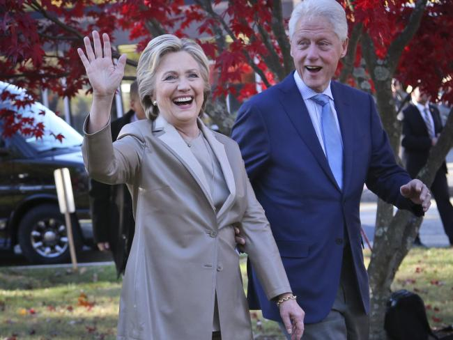 Hillary Clinton pictured with husband Bill on election day, won 79 per cent of the vote in New York City, where she is hugely popular. Picture: AP/Seth Wenig