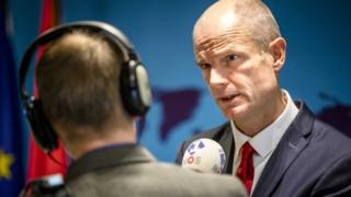 Stef Blok talks to journalists in the parliament in The Hague on 8 January