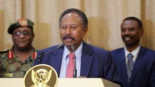 Abdalla Hamdok addresses the media following his swearing in at the presidential palace in Khartoum, Sudan, 21 August 2019