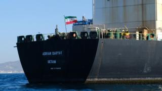 An Iranian flag flutters on board the Adrian Darya 1 oil tanker