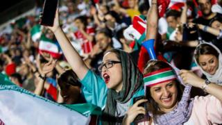 Female football fans cheering at the World Cup 2018
